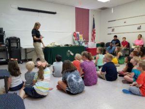 Debora Waz shows a turtle
