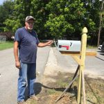 A Burnsville city employee helps out with our makeshift mailbox.