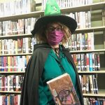 Charlotte at the Burnsville Library in costume on yet another day to hand out Summer Reading Packets!