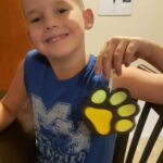 This is Mikey from Tishomingo. Mikey finished his paw print craft.